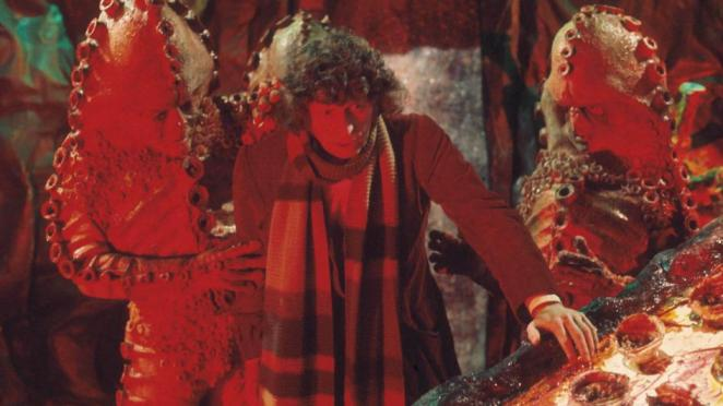 Tom Baker is menaced by Zygons