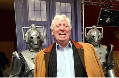 Tom Baker as the Curator with his Cybermen bodyguards